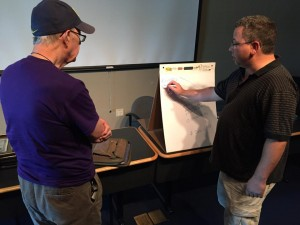 "Jeff Baugher explains his ""hack"" to Bob de Hilster using the model given to participants of the Hackathon."